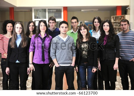 happy students people group portrait at university  indoor building - stock photo