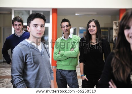 happy students people group portrait at university  indoor building