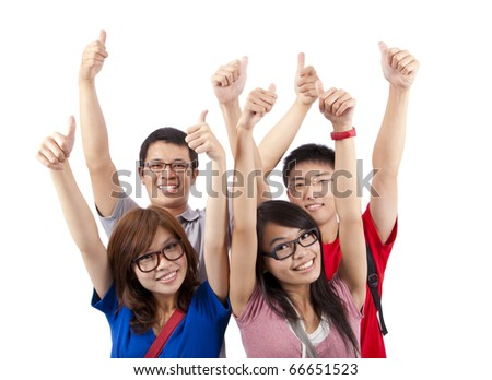 Happy students showing thumbs up and isolated on white background - stock photo