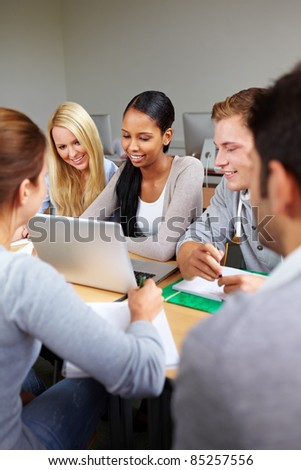 Happy study group with students in university - stock photo