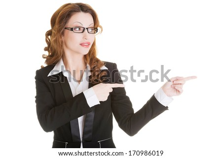 Happy success business woman pointing on copy space, isolated on white  - stock photo