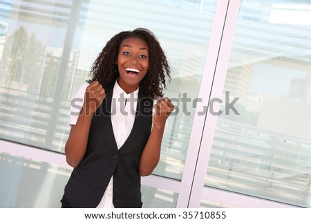 Happy successful African American business woman at company celebrating - stock photo