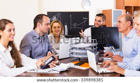 Happy successful business colleagues during conference call indoors - stock photo