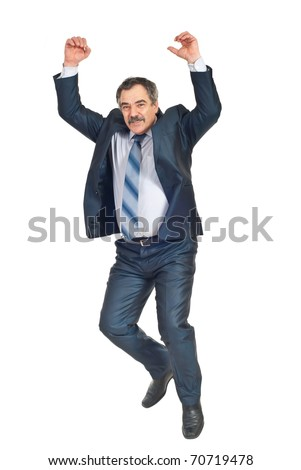Happy successful business man jumping with arms raised isolated on white background - stock photo