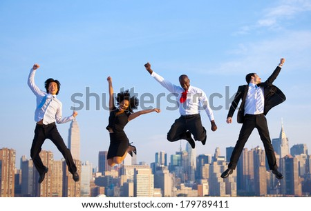 Happy Successful Business People Celebrating and Jumping in New York City - stock photo