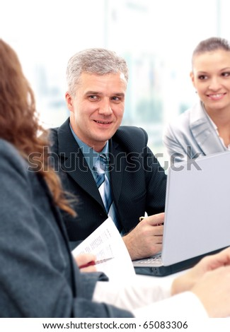 Happy successful business people in a meeting - stock photo