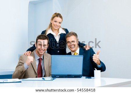 Happy successful business team celebrate in their modern office - stock photo