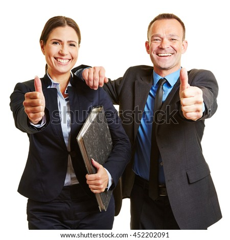 Happy successful business team holding their thumbs up - stock photo