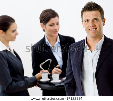 Happy successful business team working smiling at office. - stock photo