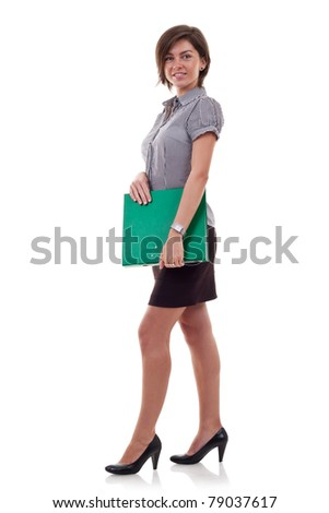 Happy successful business woman holding a folder. Isolated over white background