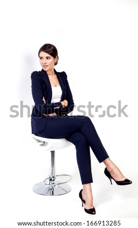 Happy successful business woman in office chair on white background - stock photo