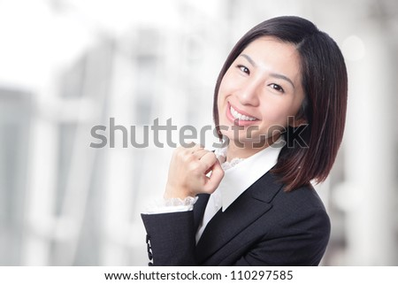 Happy successful business woman smile face in the office background, model is a asian beauty - stock photo
