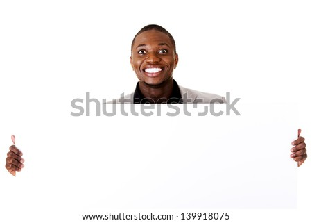 Happy successful businessman holding and showing blank advertisement. Isolated on white. - stock photo