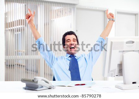 Happy successful businessman in a modern office. - stock photo