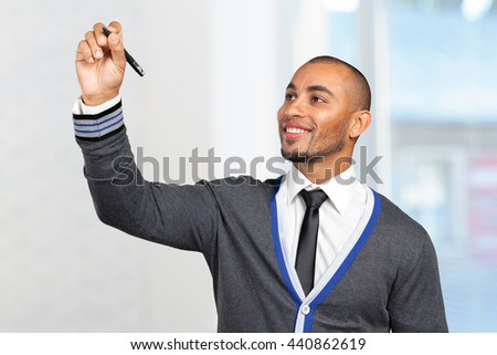 Happy successful businessman pointing on copy space - stock photo