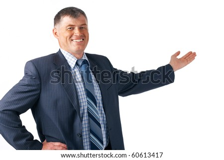 Happy successful businessman pointing to a background.