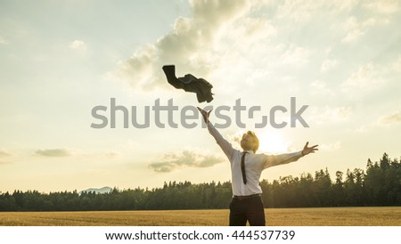 Happy Successful Businessman Throwing His Coat in the Air for being Free of Something with Wide Open Arms. - stock photo