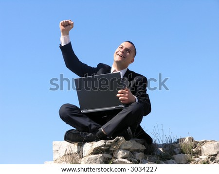 Happy,successful businessman with laptop! - stock photo