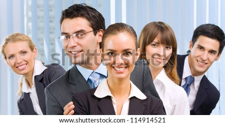 Happy successful five businesspeople at office - stock photo