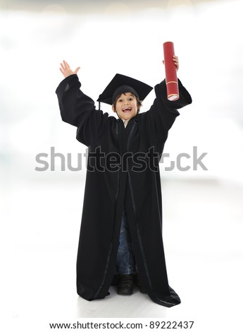 Happy successful kid with diploma and graduating clothes - stock photo
