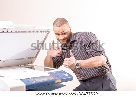 happy successful man in office near copier - stock photo
