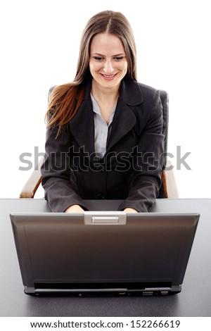 Happy successful young caucasian businesswoman at her desk with a laptop, isolated on white background