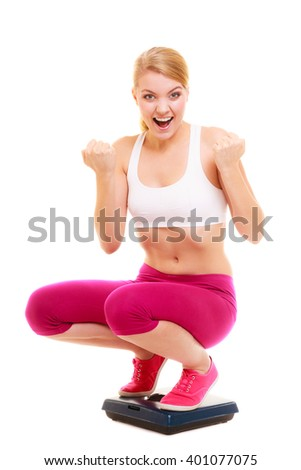 Happy successful young woman girl with measuring tape on weighing scale clenching her fists. Slimming and dieting. Healthy lifestyle concept. Isolated on white background.  - stock photo