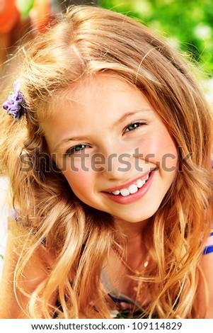 Happy summer girl having fun outdoors. - stock photo