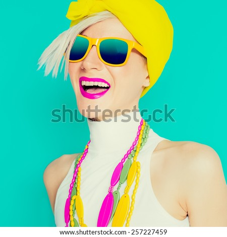 Happy Summer Girl in trendy bright ?ccessories on blue background - stock photo