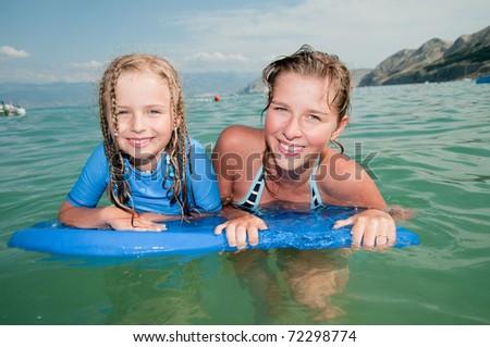 Happy summer vacation - boarding girls - stock photo