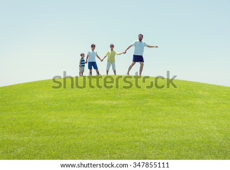 Happy summer vacation for family on green meadow near sea - stock photo
