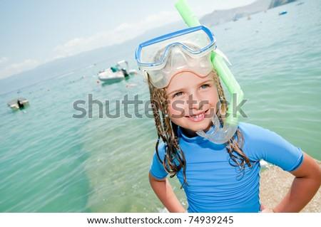 Happy summer vacation - snorkel girl portrait - stock photo