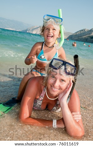 Happy summer vacation - snorkeling with mother - stock photo