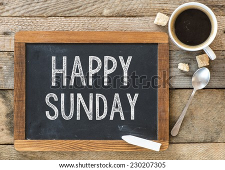Happy Sunday sign on Blackboard. Blackboard with Happy Sunday sign and cup of coffee on wooden background. - stock photo