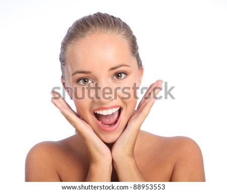 Happy surprise for beautiful young teenager girl with lovely big smile and brown eyes, showing delight and excitement with both hands raised. - stock photo