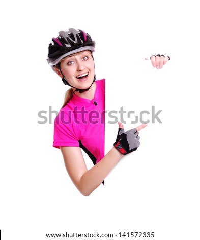 Happy surprised cyclist girl pointing to the blank board on white background - stock photo