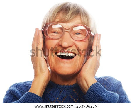 Happy surprised senior woman looking at camera isolated on white background  - stock photo