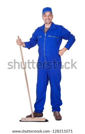 Happy Sweeper Posing With Brush On White Background