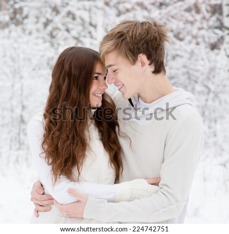 happy sweethearts looking at one another - stock photo