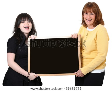 Happy teacher and student holding blank chalkboard over white. - stock photo