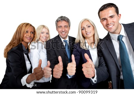 Happy team of business colleagues gesturing a thumbs up sign on white - stock photo