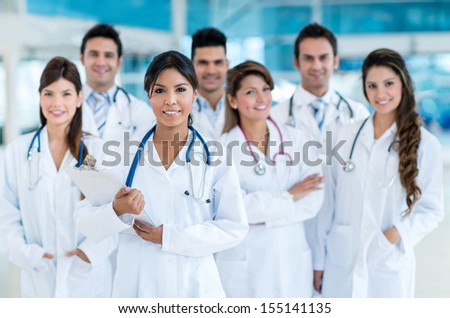 Happy team of doctors at the hospital