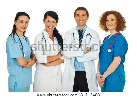 Happy team of four doctors standing in a row isolated on white background