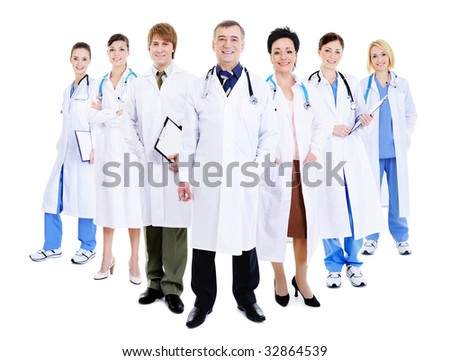 happy team of successful doctors standing together in hospital gowns - stock photo