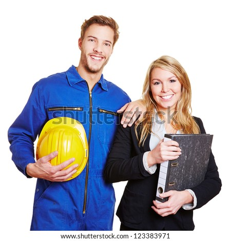 Happy team of worker in overall and business people in a suit - stock photo