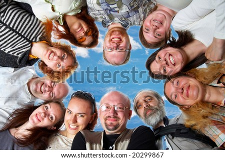 Happy team. 11 peoples. On blue sky. - stock photo