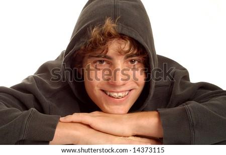 happy teen boy wearing braces on his teeth - stock photo