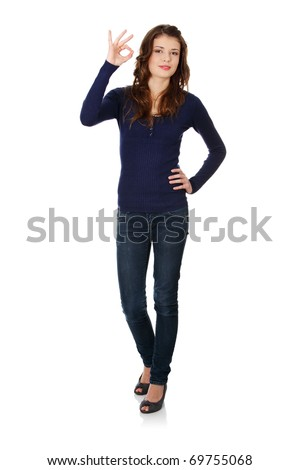 Happy teen girl gesturing perfect, isolated on white - stock photo