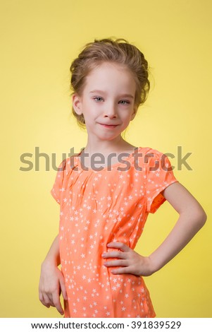 happy teen girl half length portrait isolated on yellow background.