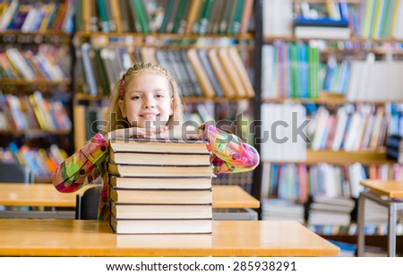 Happy teen girl in library - stock photo